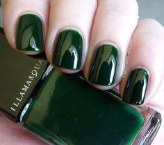 Glossy dark green nails.