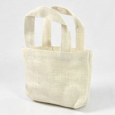 Stylish party favor tote bags can be used for a wide variety of applications and sized 5 x 5 x 2 and sold in a 12 pack. Burlap Tote, Jute Tote Bags, Reusable Tote Bags, Burlap Fabric, Burlap Ribbon, Colored Burlap, Apron Pockets, Gift Bags, Off White