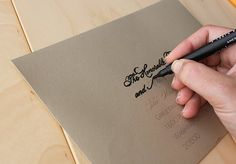 DIY calligraphy for envelopes is as easy as creating a computer template using your favorite font, printing onto envelopes in a light grey and tracing with a high quality pen.