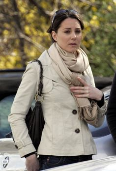 Young Kate Middleton in a white jacket and scarf for fall. Casual street style from before her marriage and title of Duchess of Cambridge