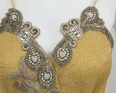 Detail of a George Stavropoulos beaded evening dress, 1980s.