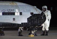 Technicians conduct post-landing operations on the X-37B Orbital Test Vehicle at Vandenberg Air Force Base, December 2010. REUTERS/U.S. Air Force