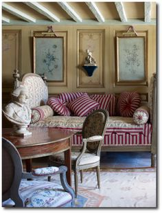 ~In the breakfast room, the sofa is by Georges Jacob, and the table, medallion chairs, and daybed are all 18th century. Coorengel And Calvagr...