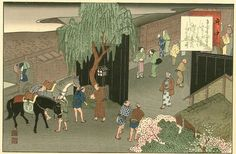 """Arriving at Fuchu (station #19), Yaji and Kita eagerly show up at the gates to the Abekawa-chō, the local equivalent of the Yoshiwara """"pleasure quarter"""" in Edo."""