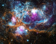 Although there are no seasons in space, this cosmic vista invokes thoughts of a frosty winter landscape. It is, in fact, a region called NGC 6357 where radiation from hot, young stars is energizing the cooler gas in the cloud that surrounds them.   This composite image contains X-ray data from NASA's Chandra X-ray Observatory and the ROSAT telescope (purple), infrared data from NASA's Spitzer Space Telescope (orange), and optical data from the SuperCosmos Sky Survey (blue) made by the United…