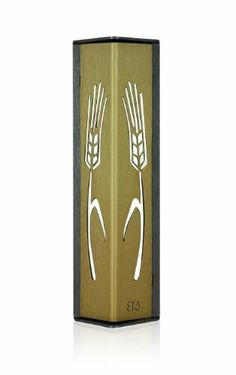 Gold on Charcoal Wheat Sheaves Design Mezuzah from Shraga Landesman by World of Judaica. $52.00. This stylized take on the classic mezuzah has cutout wheat sheaves details. Its contrast of colors will add an elegant statement to your doorway. Handmade from brushed aluminum, this mezuzah has a trendy aesthetic. This is a stunning show piece for all doorways. Design elements combine stylized wheat sheaves pattern and triangular shape, incorporating the modern and the clas...
