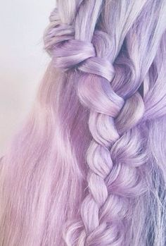 Really pretty lilac pinkish pastel hair in a side braid.