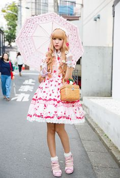 This is Emo, a 19-year-old girl we spotted on the street in Harajuku. She has long, blond hair and is wearing cute lolita fashion.Her strawberry print...