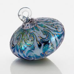 Rococo by Bryce Dimitruk: Art Glass Ornament available exlusively at www.artfulhome.com This luminous blown glass ornament dazzles with ripples of iridescent green and blue on a pearly periwinkle backdrop.