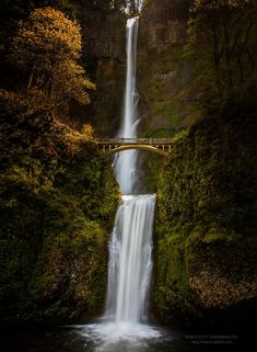 Multnomah Falls, Oregon, USA   Located along the Columbia River Highway, this historic bridge spans before the incredible Multnomah Falls waterfall.