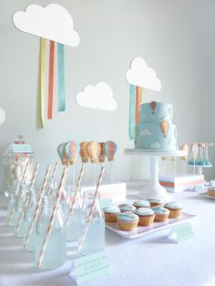 "This lovely HOT AIR BALLOON FIRST BIRTHDAY PARTY was submitted by Mariana Carvalho of Peace of Cake in Portugal. I love all the darling ideas here. This theme would be fabulous for a baby shower, too. Some of my favorite elements of this hot air balloon party are: The hot air balloon cookie pops The ""cloud bit"" marshmallows The cloud and streamer backdrop and MORE!"