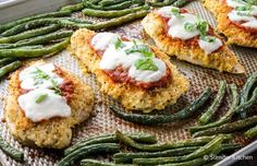 Sheet Pan Healthy Chicken Parm with green beans right out of the oven.