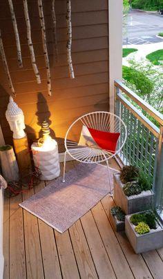 Balcony ideas- Mid Century Chair- OP Art Pillow- Succulents Stone Planters