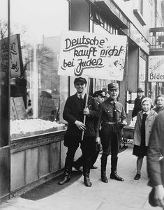"prev pinner note: Germany, An SA soldier near a Jewish owned store on the day of the boycott. The sign reads: ""Germans! Do not buy from the Jews. Jewish History, World History, World War Ii, Ww2 History, The Third Reich, Lest We Forget, Persecution, Wwii, The Past"