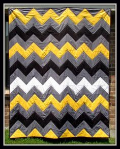 Looking for quilting project inspiration? Check out Solids HST Chevron Quilt by member LisaLakeJohnson.