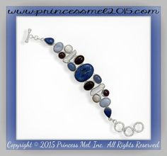 Double row polished sterling silver and stone toggle bracelet with 30mm x 22mm oval blue lapis center stone. Other stones include 16.5mm x 12mm oval blue lace agate, 15.5mm x 11.5mm oval amethyst, 13.5mm x 10mm chalcedony, 10mm cultured freshwater coin pearls and 25mm x 12mm baroque pearls. All sizes are approximate. .925 Sterling Silver