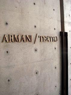 Teatro Armani, Milan, by Tadao Ando Hotel Signage, Wayfinding Signage, Signage Design, Logo Design, Graphic Design, Visual Merchandising, Armani Hotel, Building Signs, Concrete Architecture