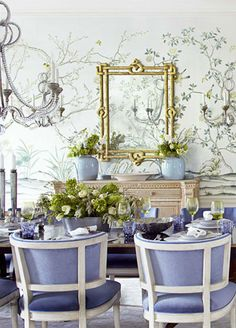 Beautiful room with gorgeous colors, mural effect on the walls, mirror and chandelier.