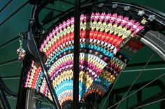 beautiful crochet enhancer for your bike! In Staphorst, a small town in the Netherlands, the women make these to protect their skirts from getting stuck in the wheel.