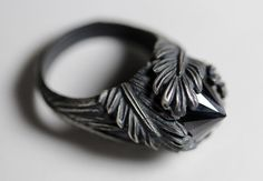 """a emotive ring featuring two unique components, a vintage feather ring has been married to an inverted black cz """"diamond"""""""