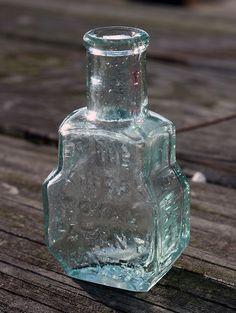 Turlington Balsam of Life (front) - aqua, rectangular, tooled round lip, Old Medicine Bottles, Old Glass Bottles, Antique Bottles, Vintage Bottles, Bottles And Jars, Bottle Art, Bottle Crafts, Cobalt Blue, Aqua