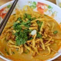 Vegetarian Khow Suey Recipe - Explore this Burmese delicacy bursting with authentic flavours. Khow suey is a one-pot meal with noodles and veggies cooked in coconut milk and garnished with peanuts and fried garlic.