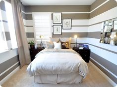 Here is the upstairs guest room, check out the dramatic use of stripes that keeps your eye moving around the room.