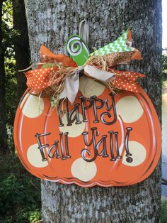 Fun & Funky Pumpkin Door hanger would look great on any door this fall season. Made with 1/4 wood, hand painted and adorned with ribbon. It
