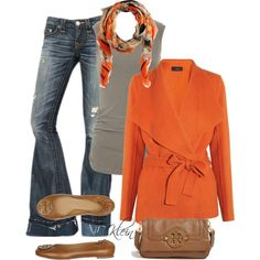 Gray top, dark gray pants, burnt orange sweater and brown accents.