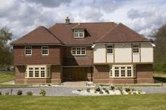 Photo about A modern family detached house in the UK. Image of driveway, kent, brick - 5217555 Modern Family, Home And Family, Family Family, Window Replacement Cost, Upvc Windows, Detached House, About Uk, Family Photos, Brick
