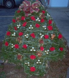 Christmas Tree with red flowers, gold bulbs and garland Grave Flowers, Cemetery Flowers, Tree With Red Flowers, Graveside Decorations, Cemetery Decorations, Fresh Flower Delivery, Local Florist, Christmas Items, Holiday Crafts