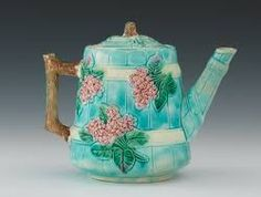 "Barrel Design Majolica Teapot with Lid  6 ¼""H  Tapered molded barrel shape with sprays of flowers and leaves, twig shape handle and handle on the lid, clear glossy aqua glaze, brown and green on the twigs, pink flowers and green leaves, unmarked. Apprx. 6 ¼""H."