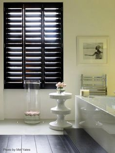 Shutters used as a bedroom screen in a dressing room Source www