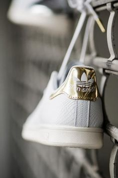 Adidas superstar sneakers with gold back