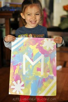 Use masking tape and paint to create your own monogrammed artwork!