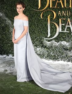 Emma Watson Wears a Fairy-Tale Dress to the UK Premiere of Beauty and the Beast.  Ice blue gown with off-the-shoulder neckline, fitted column silhouette, and a long cape train.