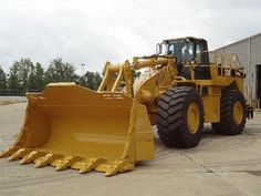 Caterpillar 988G.In 2013 Caterpillar celebrated the 50th Anniversary of this venerable wheel loader.THe 988H was replaced by the 988K.Up front the 988K went back to  z-bar linkage that began with the 988B in 1976.The 988G & 988H had the single arm boom in the picture here