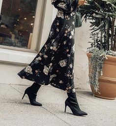 Sock boots are the trendiest shoe to wear during the fall and holiday season. They pair perfectly with a floral midi dress or even skinny pants! #fallfashion #sockboots #boots #fashion #floraldress #blogger #style #sots #shoes
