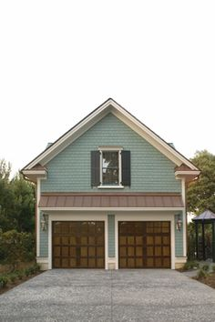 @Clopay Doors | Residential Garage Doors and Entry Doors | Commercial Doors Reserve Collection Semi-Custom Handcrafted Wood Carriage House Garage Doors Design 4 with Square 23 Glass