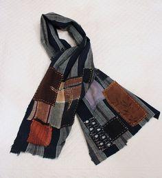 Boro scarf made from vintage Japanese shima, handwoven indigo cotton with sashiko stitching and kakishibu (persimmon dyed) patches