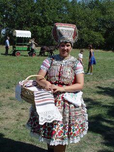 """Villagers perform agricultural labor at Folk festival """"Hontianska parada"""" Hrušov"""