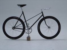 A pair of H Plus Son deep dish rims combine with the sculptural lines of the frame to provide a striking silhouette which tapers off to a pair of bullhorn bars. The sheen of polished aluminum is reflected by a fine example of drillium around the chain ring, which provides drive to a coaster hub in the rear