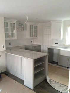 white on to and subtle grey on the bottom.  Cabinets painted in Cape May Cobblestone by Benjamin Moore.