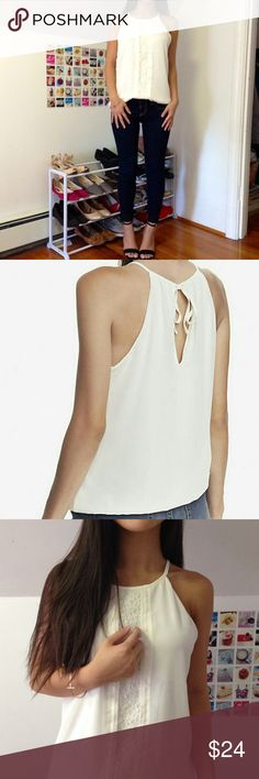 (NWT) White High Neck Laced Cami A draping, shoulder-baring style that's full of demurely sexy touches. Its billowy, sheer chiffon body is broken up in front by fine pintucks and a panel of seductive floral lace. Underneath, a full silky lining ensures appropriate coverage. Express Tops Camisoles