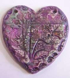 I had so much fun layering impressions from rubber stamps and brass stampings, then layering color, curing, scrubbing back, adding more color, then glazing.