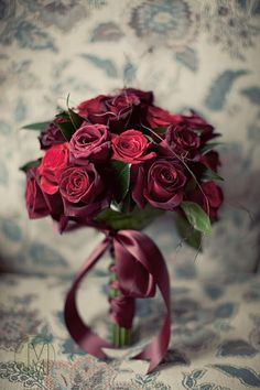 Luscious shades of dark pink, raspberry and burgundy roses make up this classically romantic bouquet.