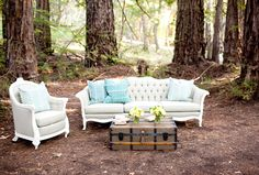 A ceremony in the heart of a redwood forest has traditional and lounge-style seating for a look that's the ultimate in unique.
