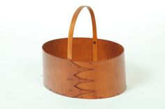 "SHAKER CARRIER -  Late 19th-early 20th century. Oval bentwood with copper tacks and three arched fingers. Bentwood handle. 11""h. 11""w."