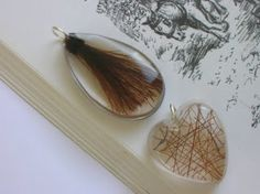 Horse hair saved within a resin mold. I don't know if it would be as stunning with Tinsel's white hair.
