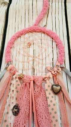 Lovely 5 unicorn inspired dream catcher in pink hues. Gorgeous unicorn and heart charms decorate the hoop, along with ribbon and lace, a pink butterfly and flower jewel which compliment the feminity of the dream catcher. Pink Marabou feathers are then fastened to the suede cord and fastened with wooden beads. This Dream Catcher would look lovely in a girls bedroom or nursery! Each Dream Catcher arrives beautifully hand wrapped with a hand written note, and few little treats to brighten up…
